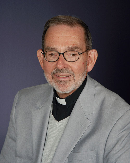 Rev. Karl Bauer : Senior Priest